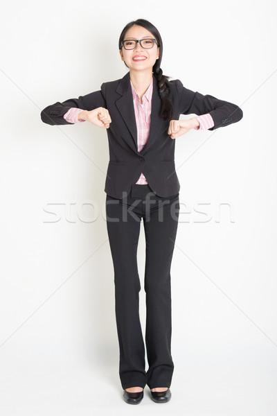 Asian businesswoman ready to jump Stock photo © szefei