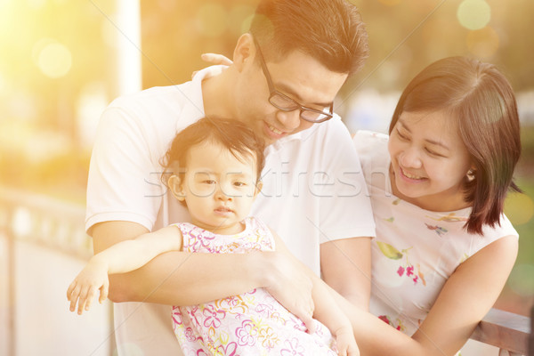 Family in summer holiday vacations, sunset Stock photo © szefei