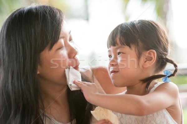 Child wipe moms mouth  Stock photo © szefei