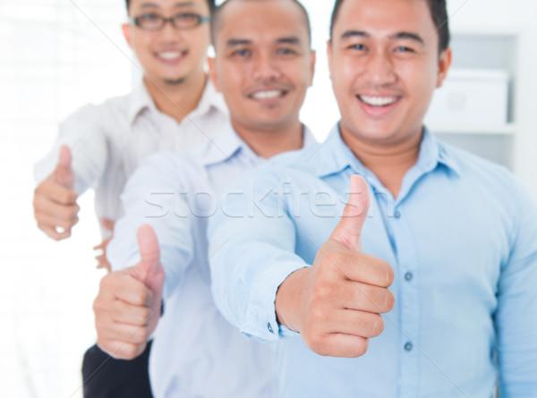 Thumbs up Southeast Asian businessmen Stock photo © szefei