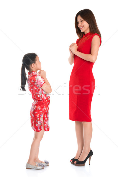 Full length Chinese parent and child greeting to each other Stock photo © szefei