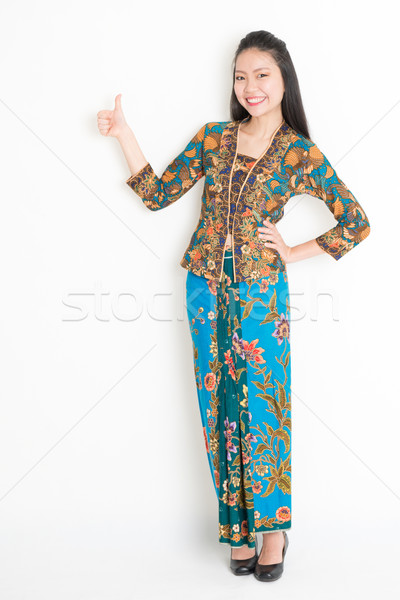 Asian girl thumb up Stock photo © szefei