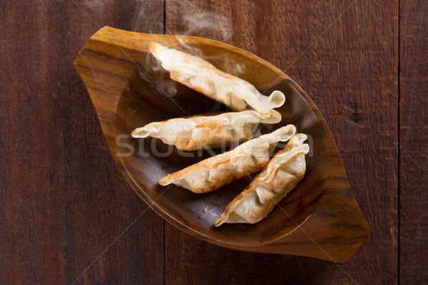 Top view Asian meal pan fried dumplings Stock photo © szefei