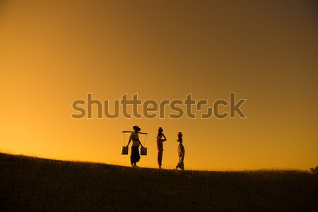 Silhouette of group Asian traditional farmers Stock photo © szefei