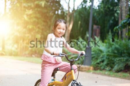 ребенка верховая езда велосипедов Открытый портрет активный Сток-фото © szefei
