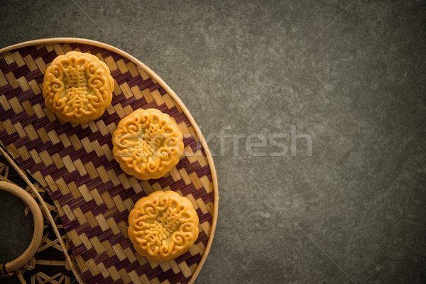 Moon cakes on bamboo background low light with copyspace  Stock photo © szefei