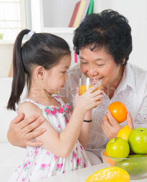 Sharing orange juice Stock photo © szefei