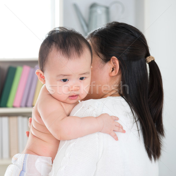 Mother pampering baby Stock photo © szefei