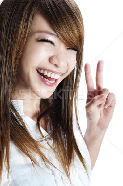 Vitória assinar bonitinho asiático mulher jovem Foto stock © szefei