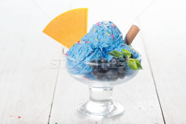 Blueberry ice cream and wafer Stock photo © szefei