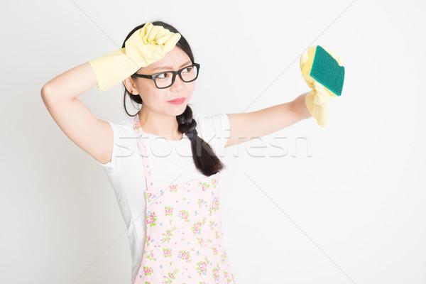 Woman Cleaning with sponge Stock photo © szefei