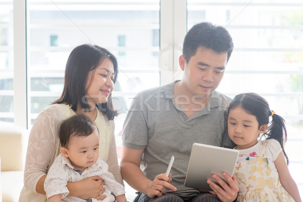 Asian people scanning QR code Stock photo © szefei