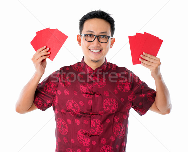 Asian Chinese man holding red packet  Stock photo © szefei