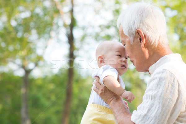 Asian grandfather kissing grandson Stock photo © szefei