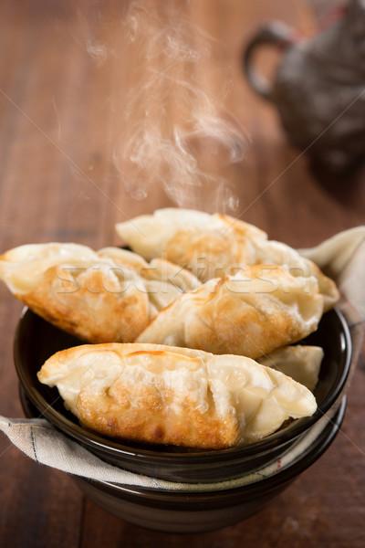 Popular Chinese dish pan fried dumplings Stock photo © szefei