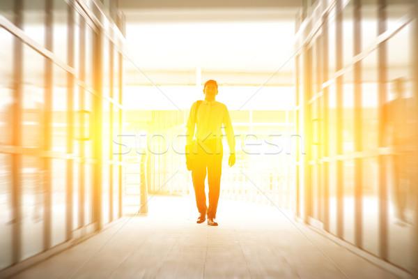 Business people walking thru modern office Stock photo © szefei