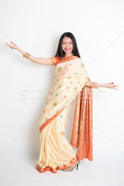 Young woman in Indian sari dress dancing Stock photo © szefei
