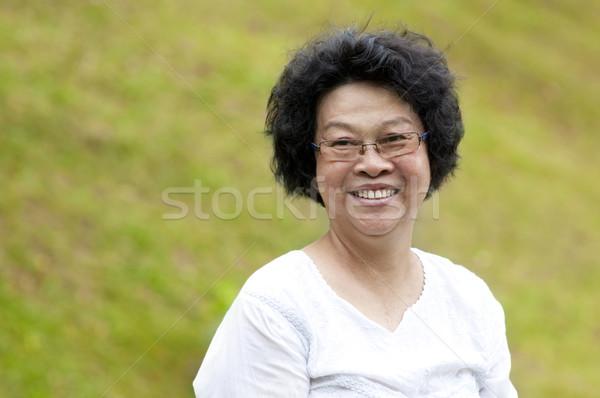 азиатских старший женщину 60-х годов парка утра Сток-фото © szefei