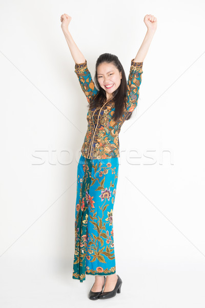 Happy Asian female arms up Stock photo © szefei