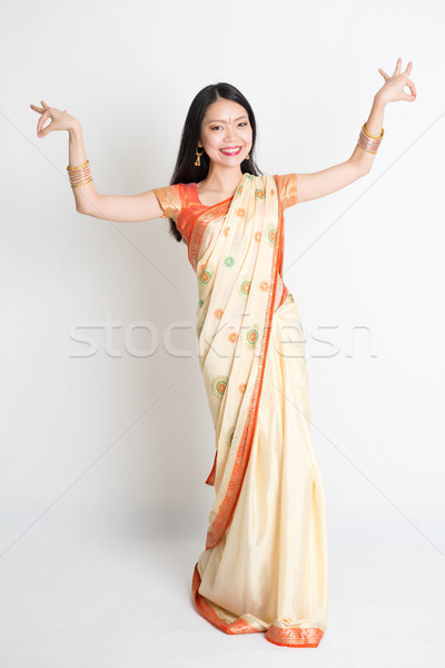 Girl in Indian sari dress dancing Stock photo © szefei