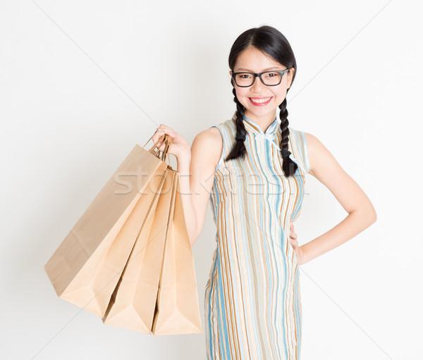 Oriental girl shopping Stock photo © szefei