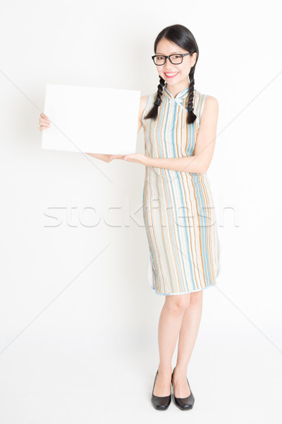 Asian female holding white blank paper card Stock photo © szefei