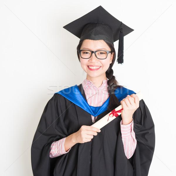 Egyetemi hallgató portré boldog érettségi talár sapka Stock fotó © szefei