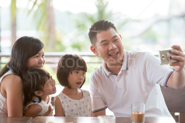 Family taking self photo Stock photo © szefei