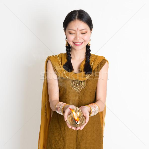 Girl holding oil lamp light Stock photo © szefei