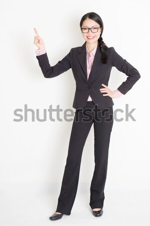 Asian businesswoman finger pointing up Stock photo © szefei