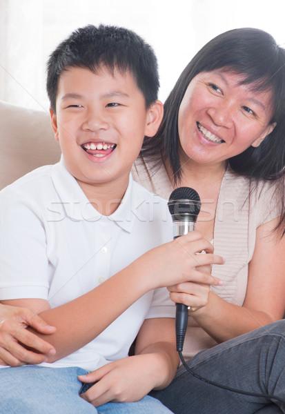 Asian family singing karaoke  Stock photo © szefei