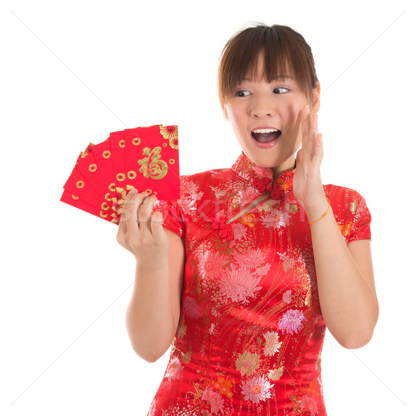 Surprise Chinese cheongsam girl holding red packets Stock photo © szefei