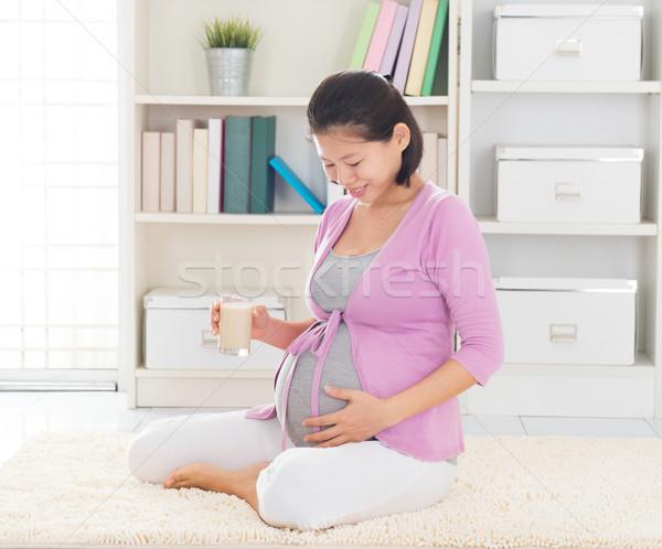 Pregnant woman drinking soymilk Stock photo © szefei