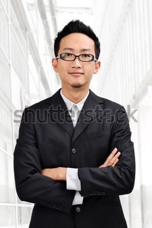 Di bell'aspetto asian maschio isolato bianco studente Foto d'archivio © szefei