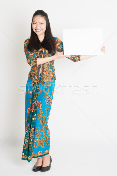 Asian girl showing placard Stock photo © szefei