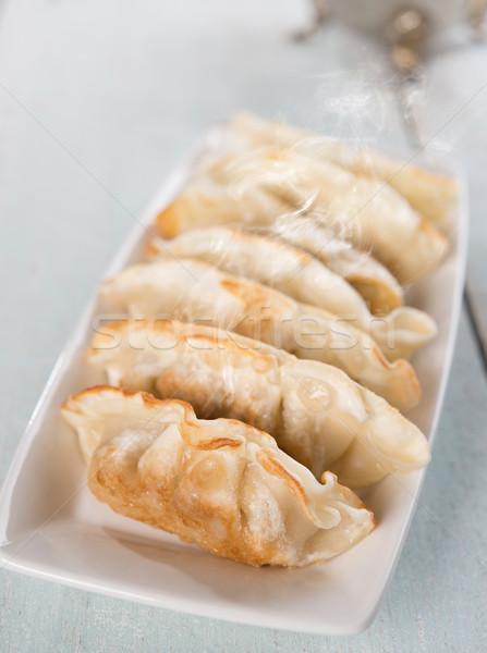 Asian food pan fried dumplings Stock photo © szefei