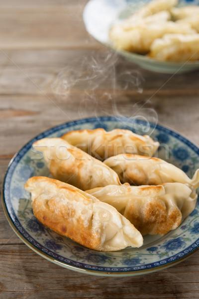 Asian dish pan fried dumplings Stock photo © szefei