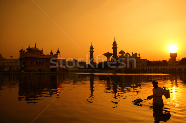 Cleaning the pool of the Golden Temple, India Stock photo © szefei