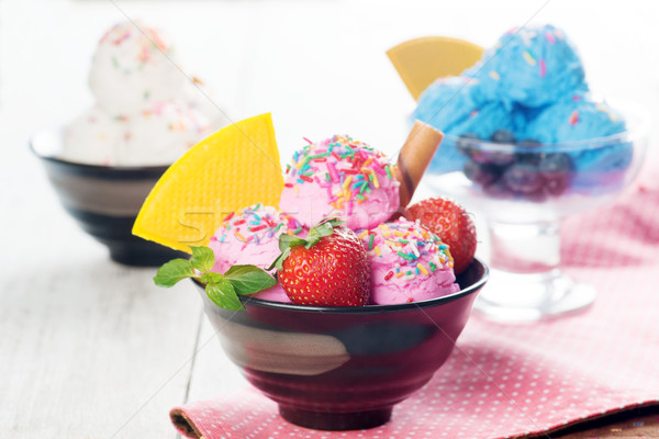 Pink, blue and white ice cream in bowl Stock photo © szefei