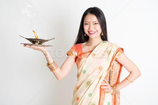 Girl with Indian sari dress holding oil lamp diya Stock photo © szefei