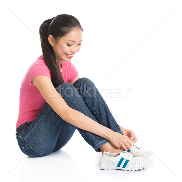 Woman wearing shoes Stock photo © szefei