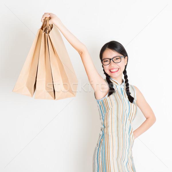 Oriental woman shopping Stock photo © szefei