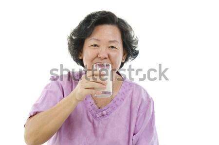 Senior mulher potável leite retrato asiático Foto stock © szefei