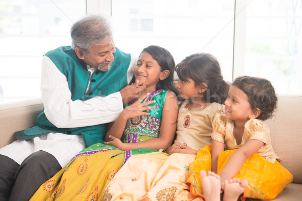 Happy Indian father and daughters Stock photo © szefei
