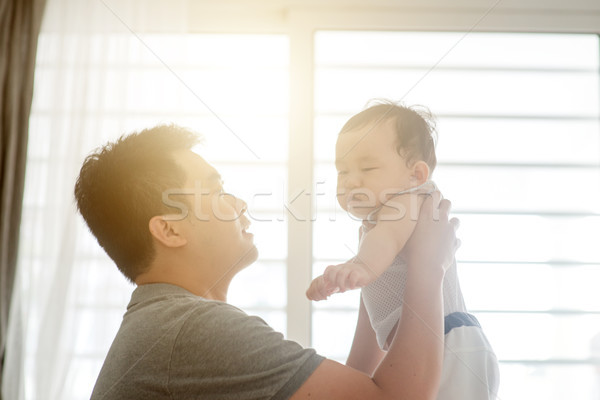 Father playing with son. Stock photo © szefei