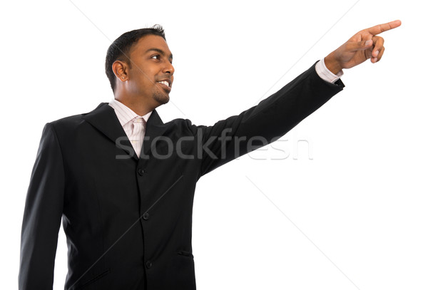 Indian businessman pointing to blank space Stock photo © szefei