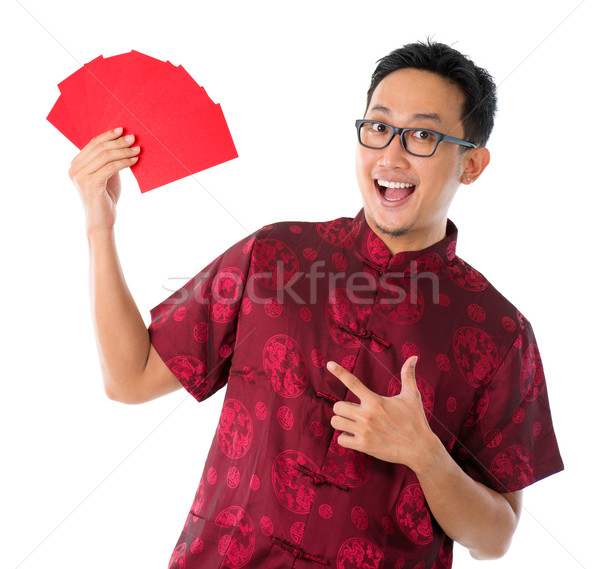 Asian Chinese man showing many red packets Stock photo © szefei
