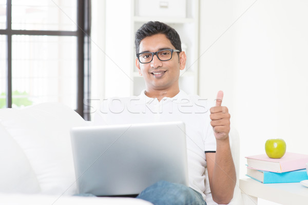 Guy working from home Stock photo © szefei