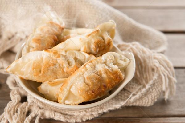 Famous Asian food pan fried dumplings Stock photo © szefei
