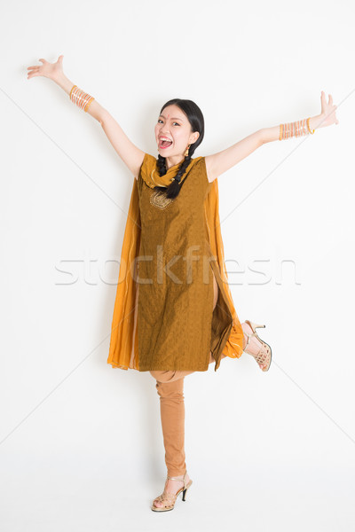 Excited Indian Chinese girl arms raised Stock photo © szefei